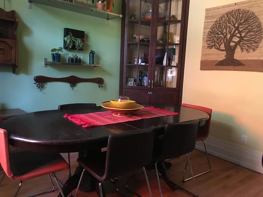 Table with extension. Adjustable (comfortable) bar stools can be used for extra seating.