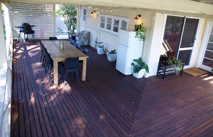 Huge outdoor deck is perfect for outdoor dining.