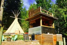 Here is your compound! A tipi, an outside kitchenette, warm outside shower, BBQ and a beach area to chil.
