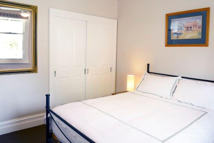 The main bedroom has a comfortable queen bed