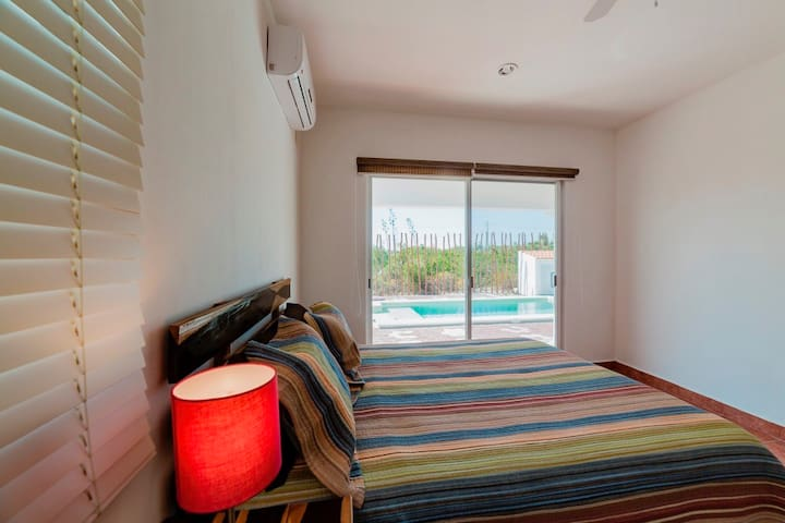 Bedroom #2 (Ground floor) with access to pool/patio