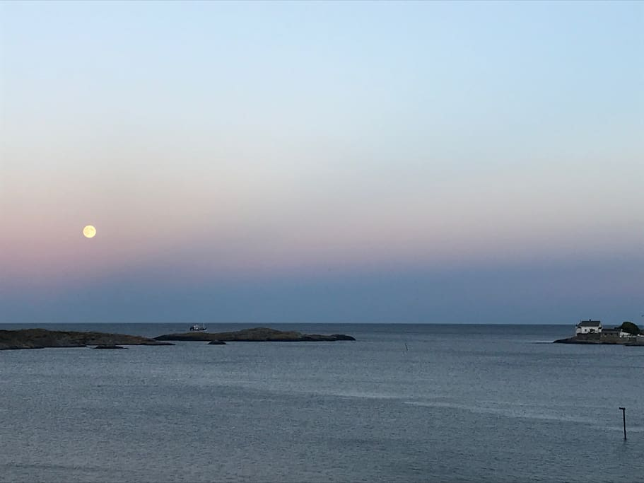Spectacular view from the living room. Stangholmen lighthouse with summer restaurant.