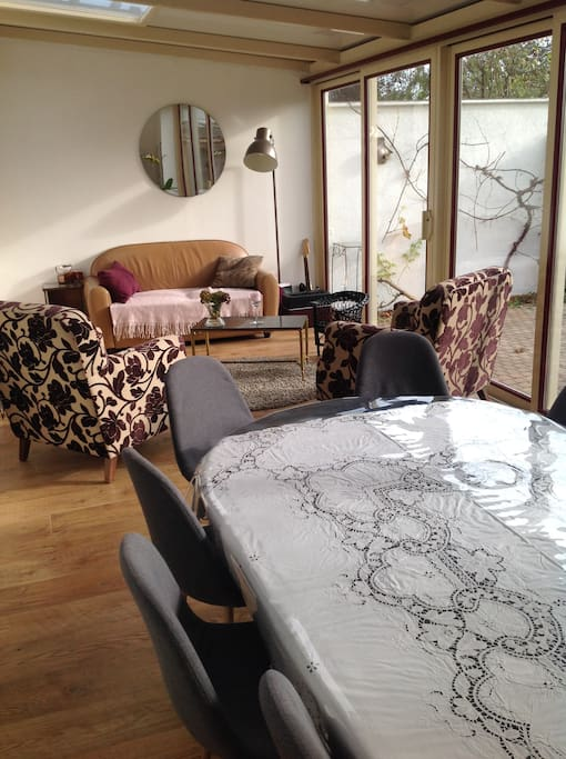 Seating for up to 12 people in the dining area of sun room