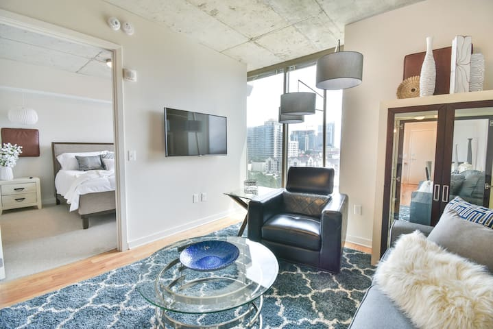 living room and bedroom view of midtown skyline