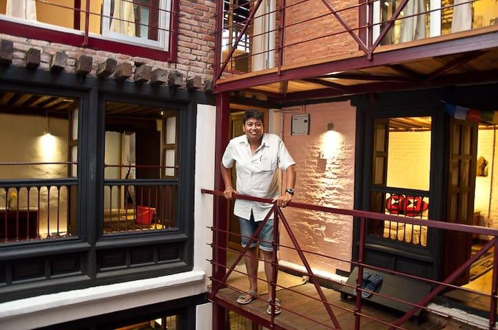 Prakash, host of Dhakwha House in the inner patio walkway
