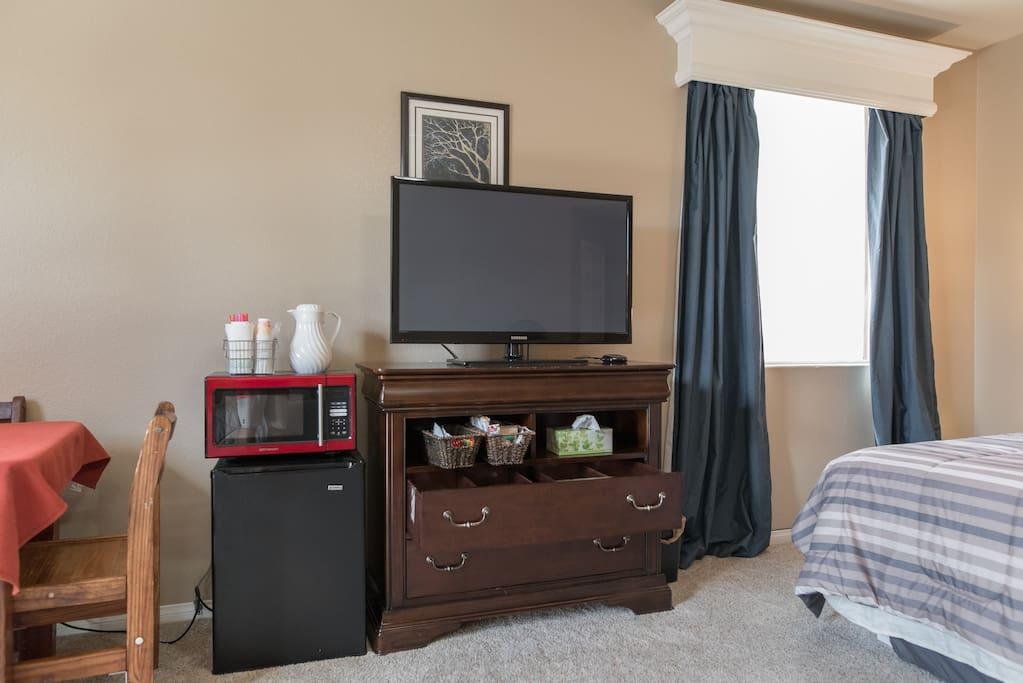 tv, microwave, fridge, breakfast supplies