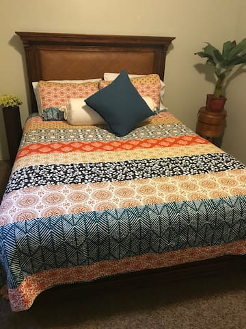 Comfy bedding. Close the blinds and curtains if you want it to be to rest well or sleep all day!