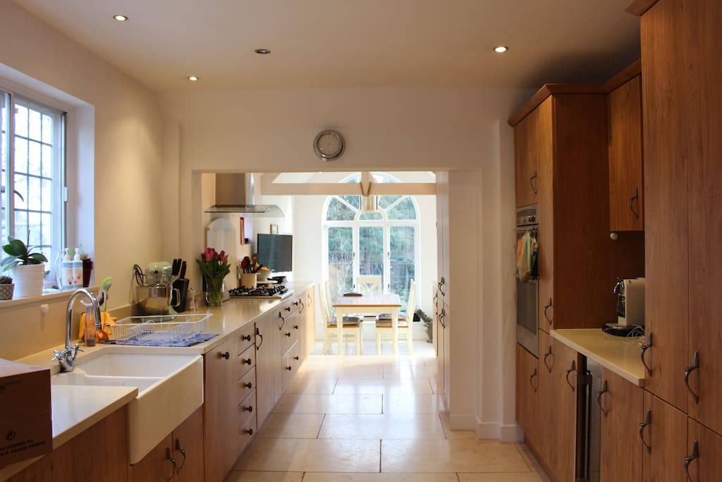 Kitchen with seating area overlooking garden and terrace
