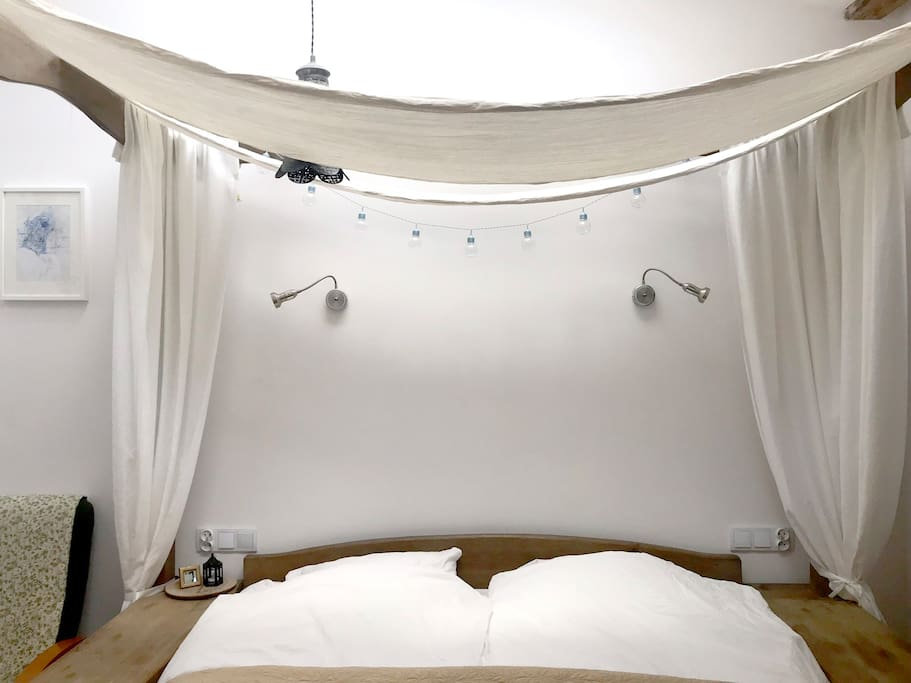 Master bedroom with four poster bed with bedding