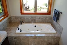 Upper level master bathroom with his & her sinks, single person Jacuzzi tub, large sit down shower, walk-in closet and spectacular ocean views