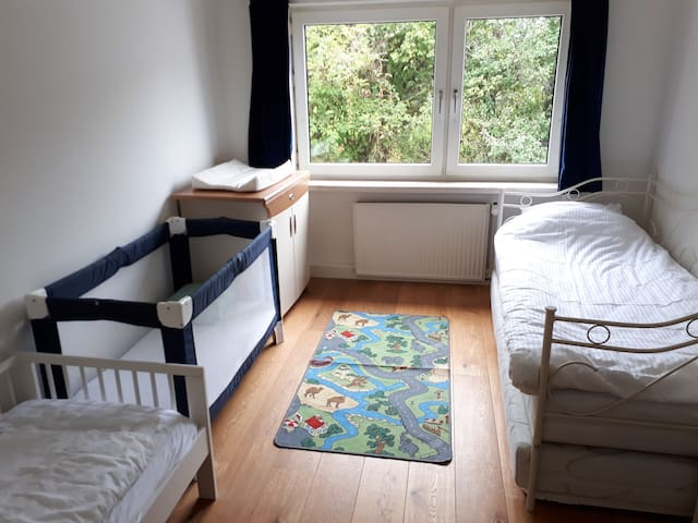 Room #3, upstairs with two beds beds for adults and two beds for children (baby and junior bed)
