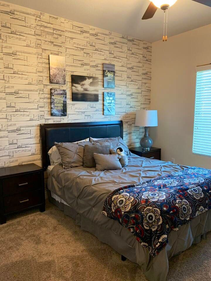 Private bedroom with Queen size mattress and plenty of pillows. THIS IS HONESTLY THE COZIEST MATTRESS!!!! Your own retreat.