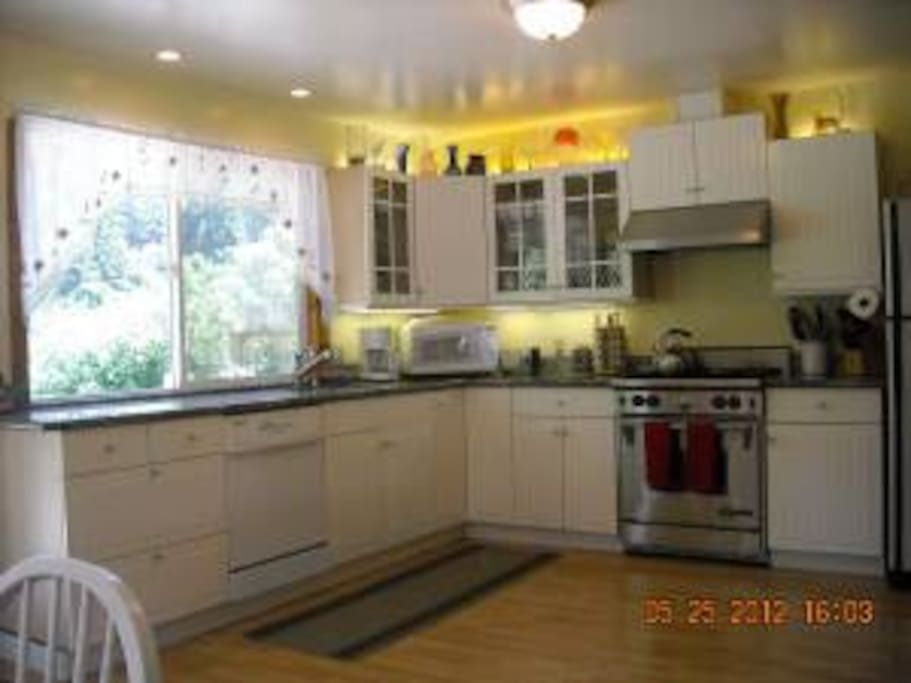 We love the kitchen, faces backyard and Russian River