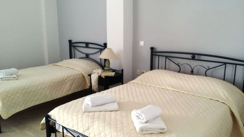 A triple room at Stavros Villas
