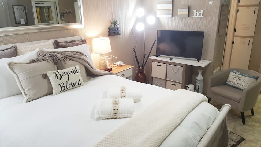 Sink into this amazing Queen Bed! Get cozy, turn on your favorite movie. Relax & Enjoy!