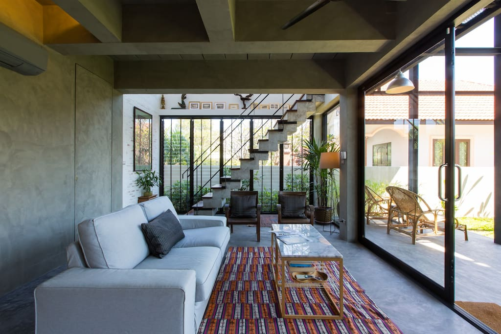 The lazy sofa overlooks the terrace and the garden beyond.