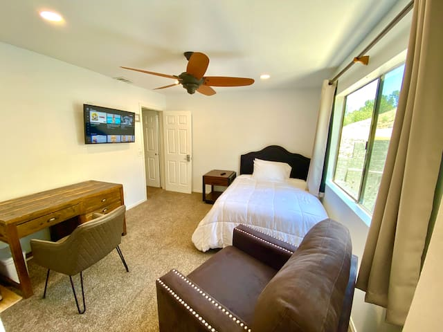 Bedroom has Full size bed with Foam Mattress Add Dimmable lighting And easy access To the backyard via private door And easy access to the kitchen that is located on the lower floor.