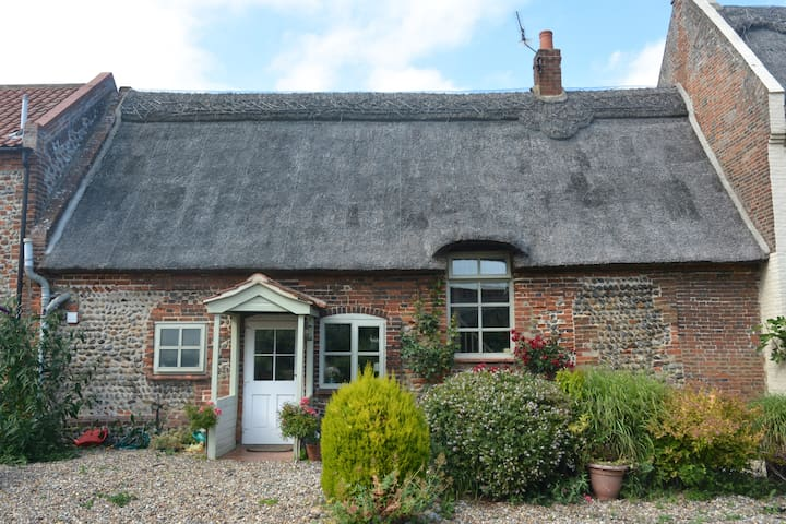 Thatched cottage in tranquil coastal village