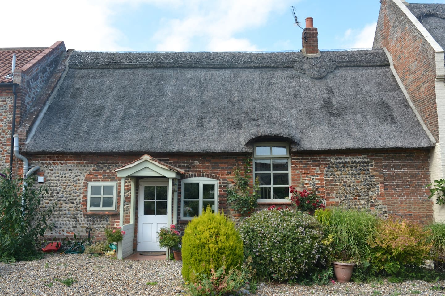 The beautiful frontage of Church Farm Cottage from the old farmyard now an open courtyard. Access is now through the enclosed rear garden.