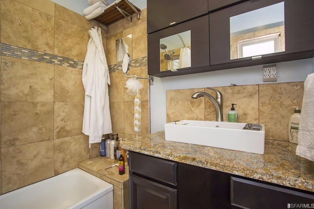 Newly remodeled Travertine and granite bathroom with a double head shower... view the Transamerica building and the bay while showering!