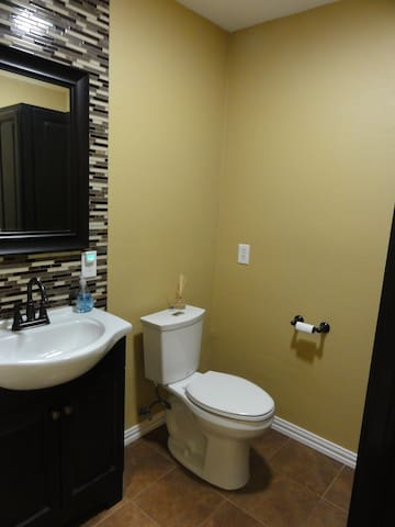 The common powder room downstairs is also available for your use if your bathroom is otherwise occupied.