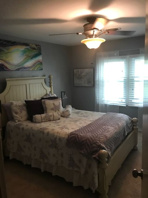 Bedroom 1: Queen bed, desk, closet, two bedside stands