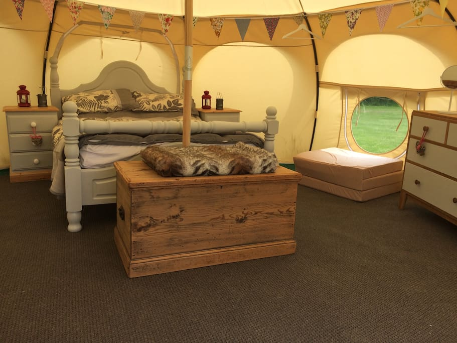 Inside our three Lotus Belle tents, a double bed and two floor mattresses, sleeping 4 with room for a 5th person.