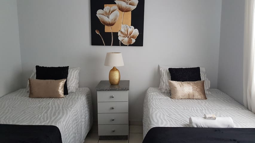 A guest bedroom with 2 x three quarter beds.