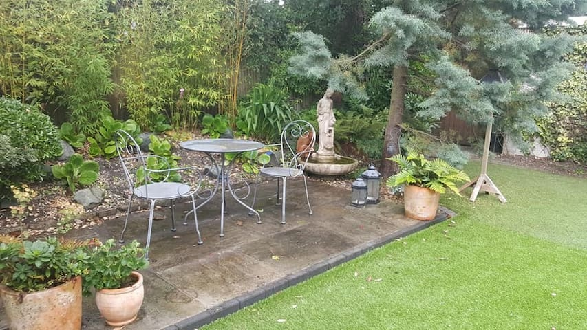 Patio - guests are welcome to use the garden.