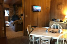 There is a small screen in the dining room that is hooked up to Roku.