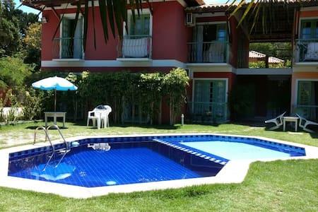 Lindo condominio com piscina à 100m da praia! - Porto Seguro - Flat