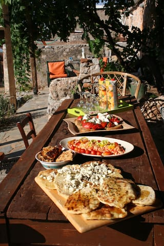 Local vegetarian dishes on a garden table