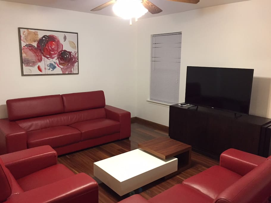 "Family room - leather furniture and 50"" screen TV"