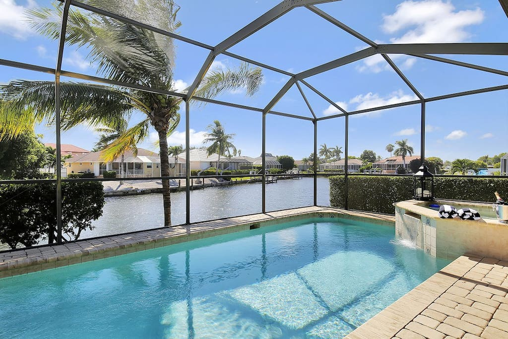 Pool and lanai area with long water views.