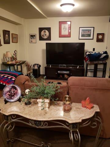 "Living Room 60"" TV/DirecTV"