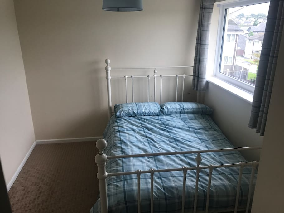 Bedroom lacking in cluttery furniture. Or homely feel.