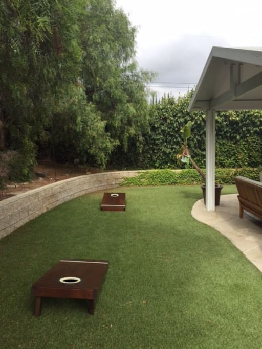 Use of cornhole game with room to roam.