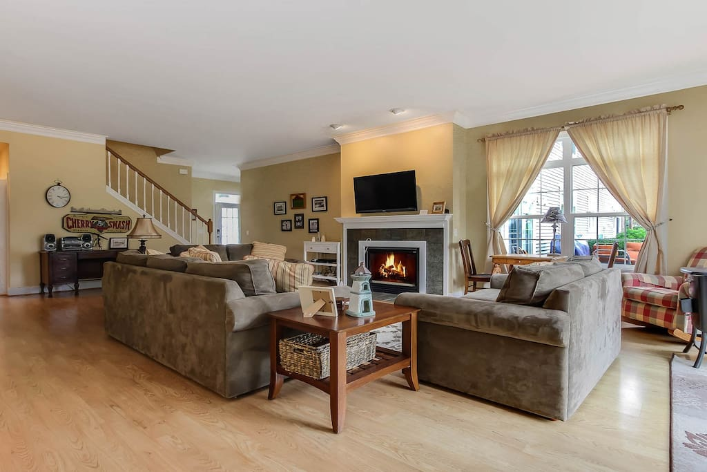 The sofas center around a gas fireplace and flat screen TV.