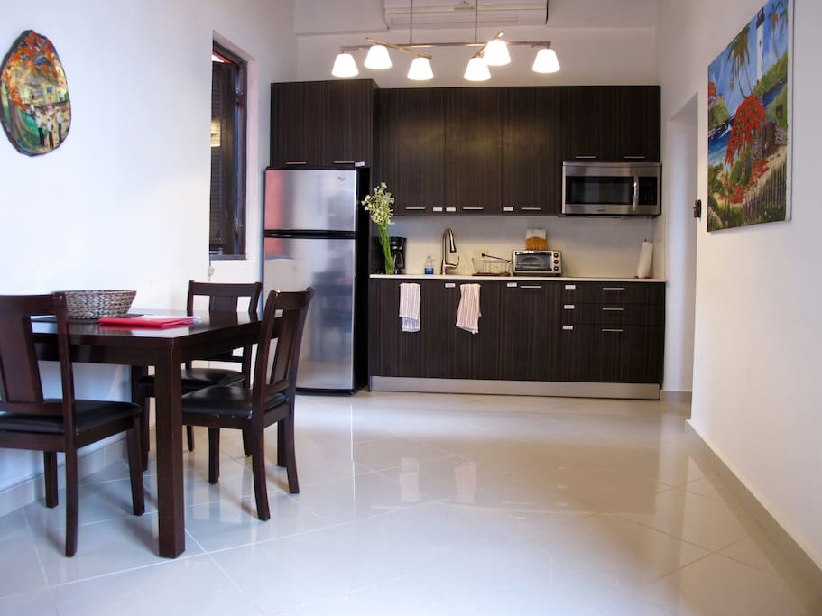 The apartment has an open floorplan, with the living room flowing into the dining space and kitchen