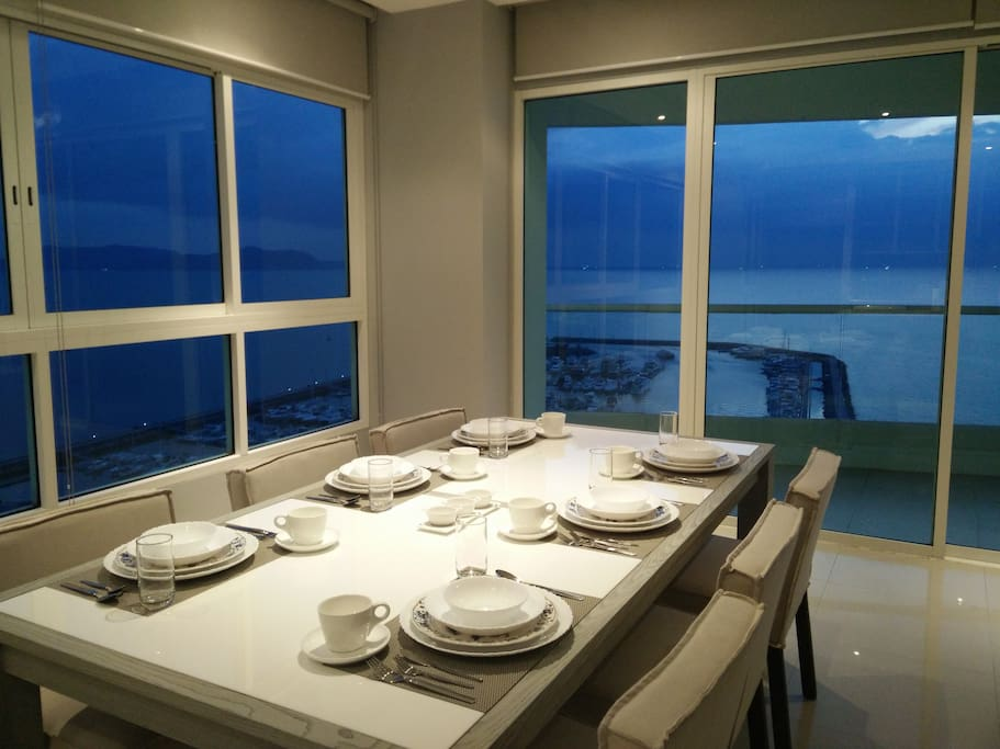 View of ocean and marina from living room and dining room. A beautiful  sight.