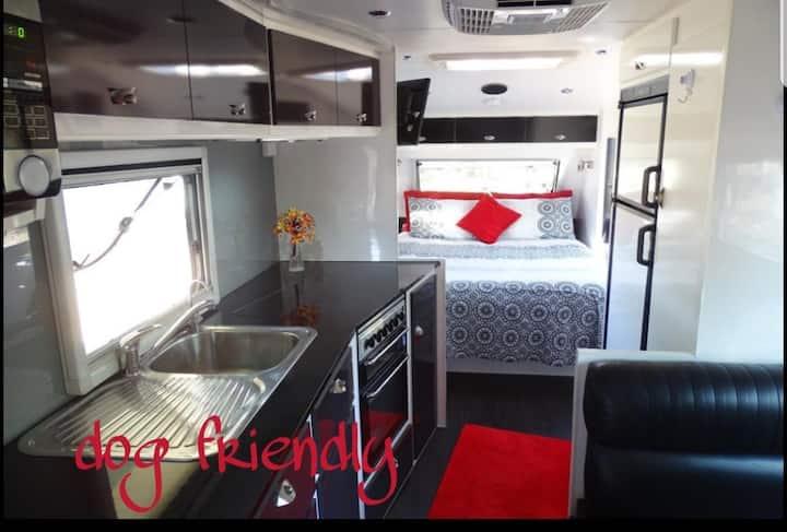 luxury caravan in a peaceful rural setting