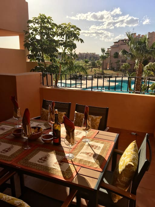 Dine out on the terrace overlooking the pool
