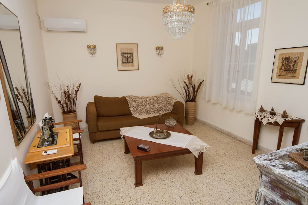 The living room is decorated with antique furnitures and traditional Rhodian pieces.
