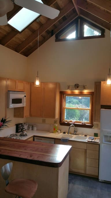 The fully equipped kitchen. Gas cooktop, full size fridge and oven, built in microwave and dishwasher.