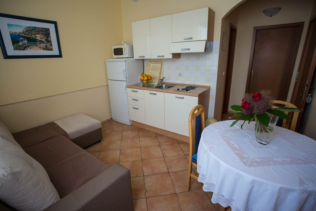 Kitchen with dinning table and sofa