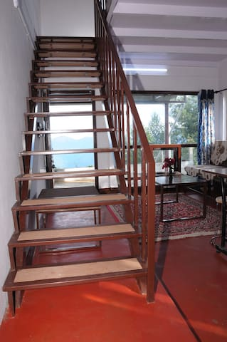 Wooden and steel framed stairs to the first floor - huttle