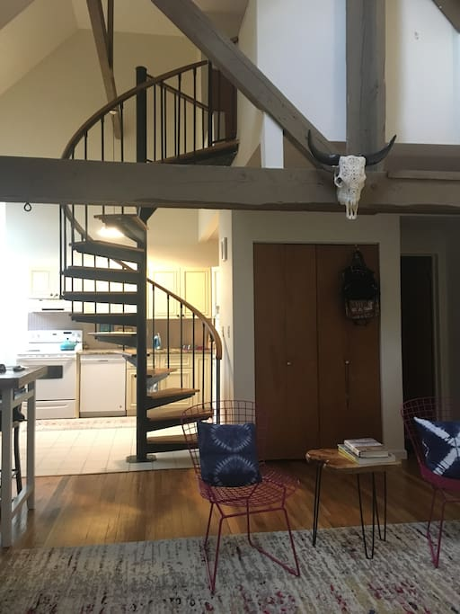 Spiral stairs to the lofted bedroom