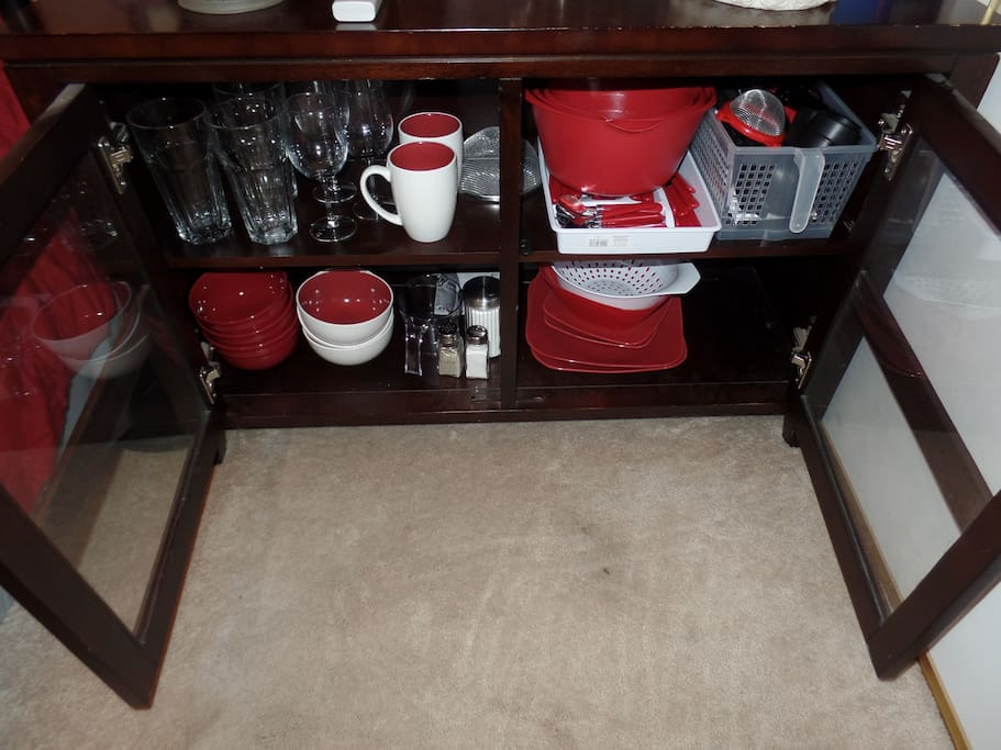 Pots, pans, plates, bowls, cups, drinking glasses, wine glasses, cooking utensils and silverware for 3 people at your finger tips.