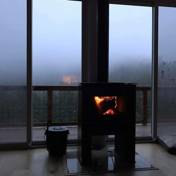 Watching the fog roll in during autumn while seating by a toasty fire.