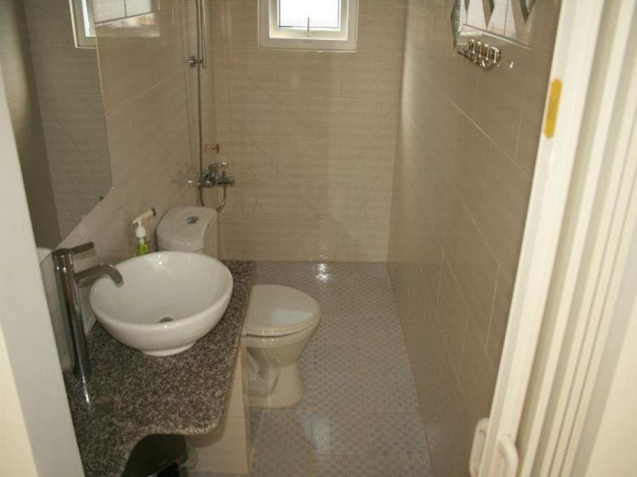 Clean bathroom with hot shower using solar heater
